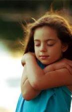 Little girl hugging herself image