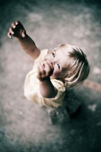 little-girl-with-reaching-arms